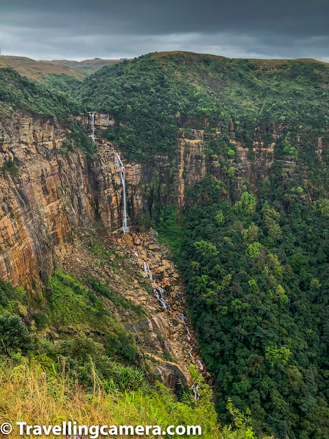 While going to Sohra/Cherrapunji, there are plenty of waterfalls come on the way.  You can take a stop and enjoy those views, but to go closer, one needs to hike a bit. Above is one of the waterfalls we saw on our way. There was a small ticket counter. One can have a 10 rupees ticket and walk 100 yards to have this beautiful view. This place doesn't only offer the view of this waterfall but also great ranges of green mountains merging into each other.