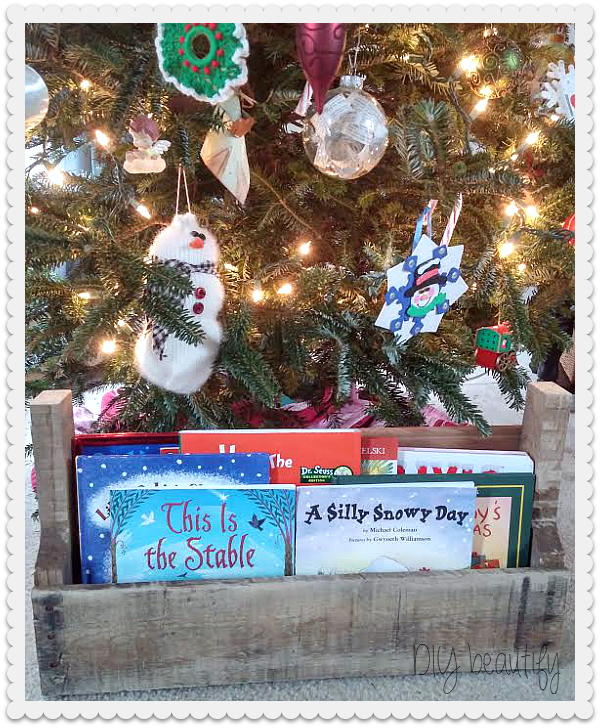 pallet wood caddy holds favorite Christmas reads at www.diybeautify.com