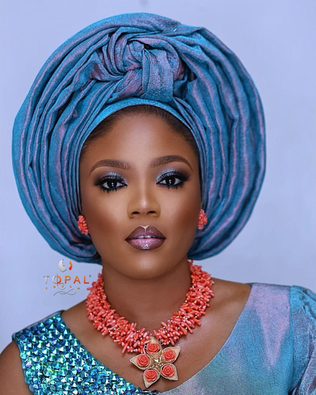 Shiny blue bridal makeup
