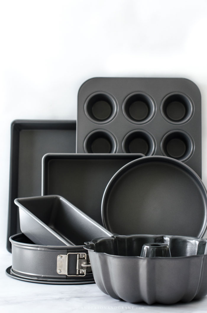 Nine essential baking pans that anyone should have in their kitchen, plus tips on how to use each one. #baking #baking101 #kitchentools #andersonandgrant