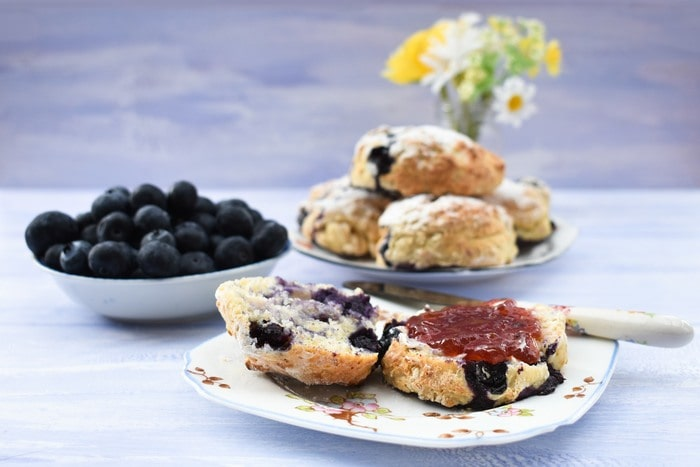 Blueberry Lemonade Scones with butter and jam on a teaplate