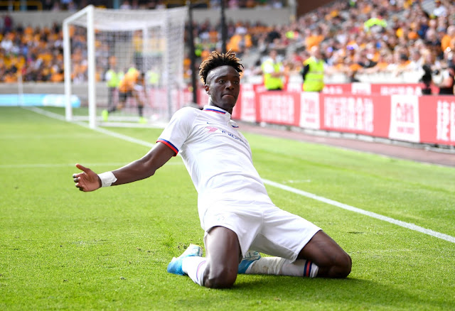 Chelsea forward Tammy Abraham celebrates scoring a hat-trick against Wolves in the Premier League
