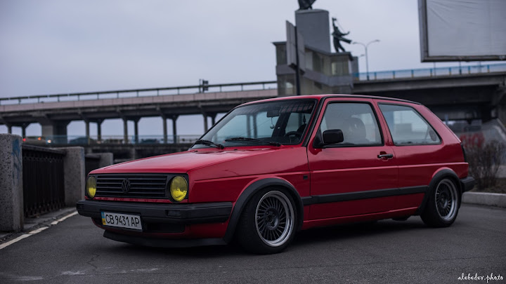 red vw golf on oz wheels