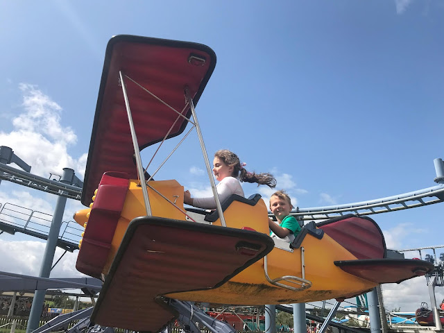 The children on a plane fair ground ride at Flamingo Land theme park