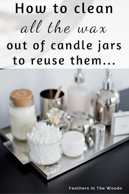 Cleaned candle jars being used in bathroom as storage