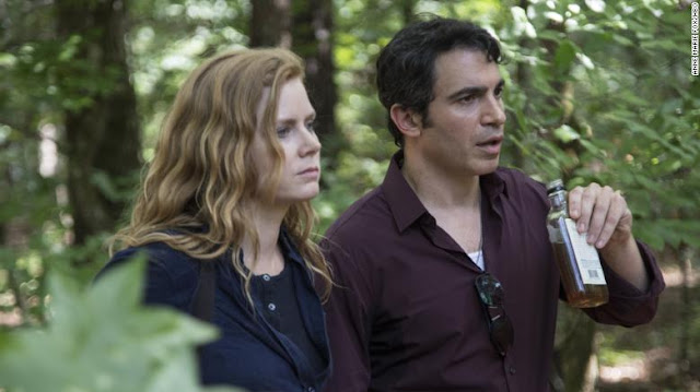 Production photo of Amy Adams as Camille and Chris Messina as Detective Richard Willis in HBO's Sharp Objects based on the book by Gillian Flynn