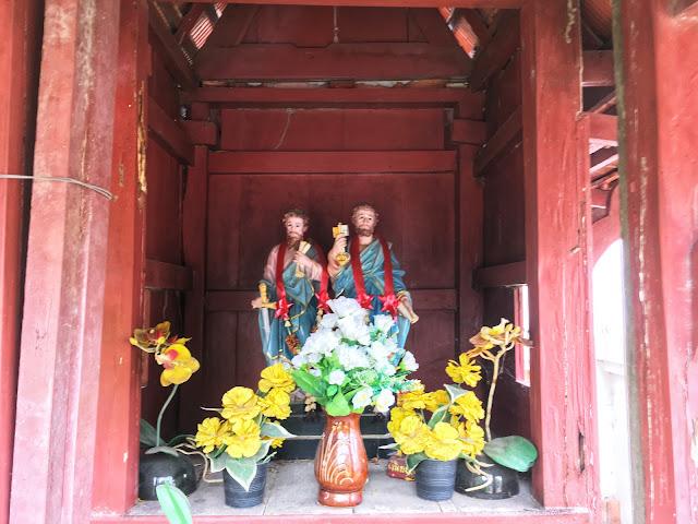 a unique Christian Thai spirit house