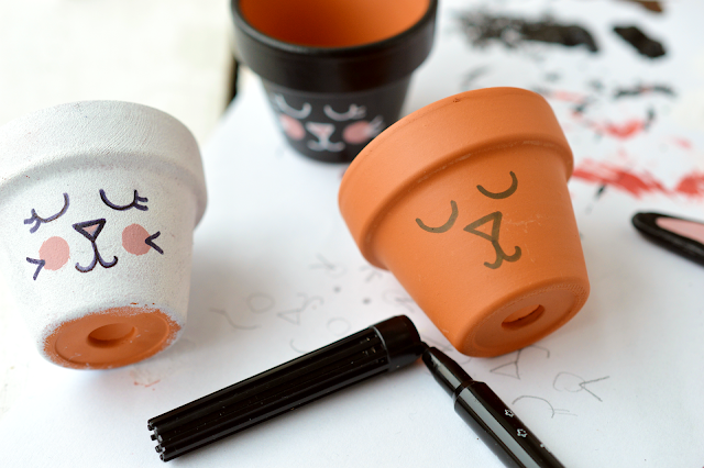 Painting the faces of DIY Bunny Egg Cup made from a mini planter by Motte's blog