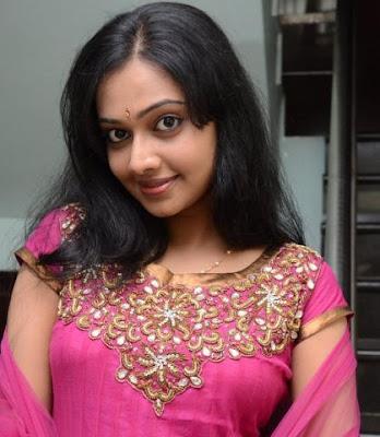 Malayalam actress  Divya Viswanath in pink dress