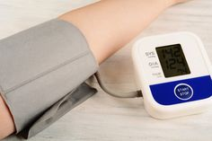 Doctor or Cardiologist measuring Hight Blood Pressure of a Patient