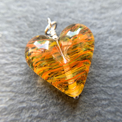 Handmade lampwork glass heart bead by Laura Sparling made with CiM Circus Tent