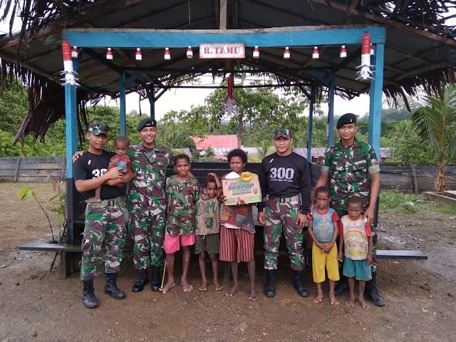 Hari Juang TNI AD  Satgas Raider 300 Berikan Bantuan Sembako Kepada Warga Yobanda