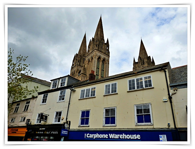 Shops being overlooked by the Cathedral in Truro, Cornwall