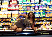 cool lady sitting in frozen section of supermarket