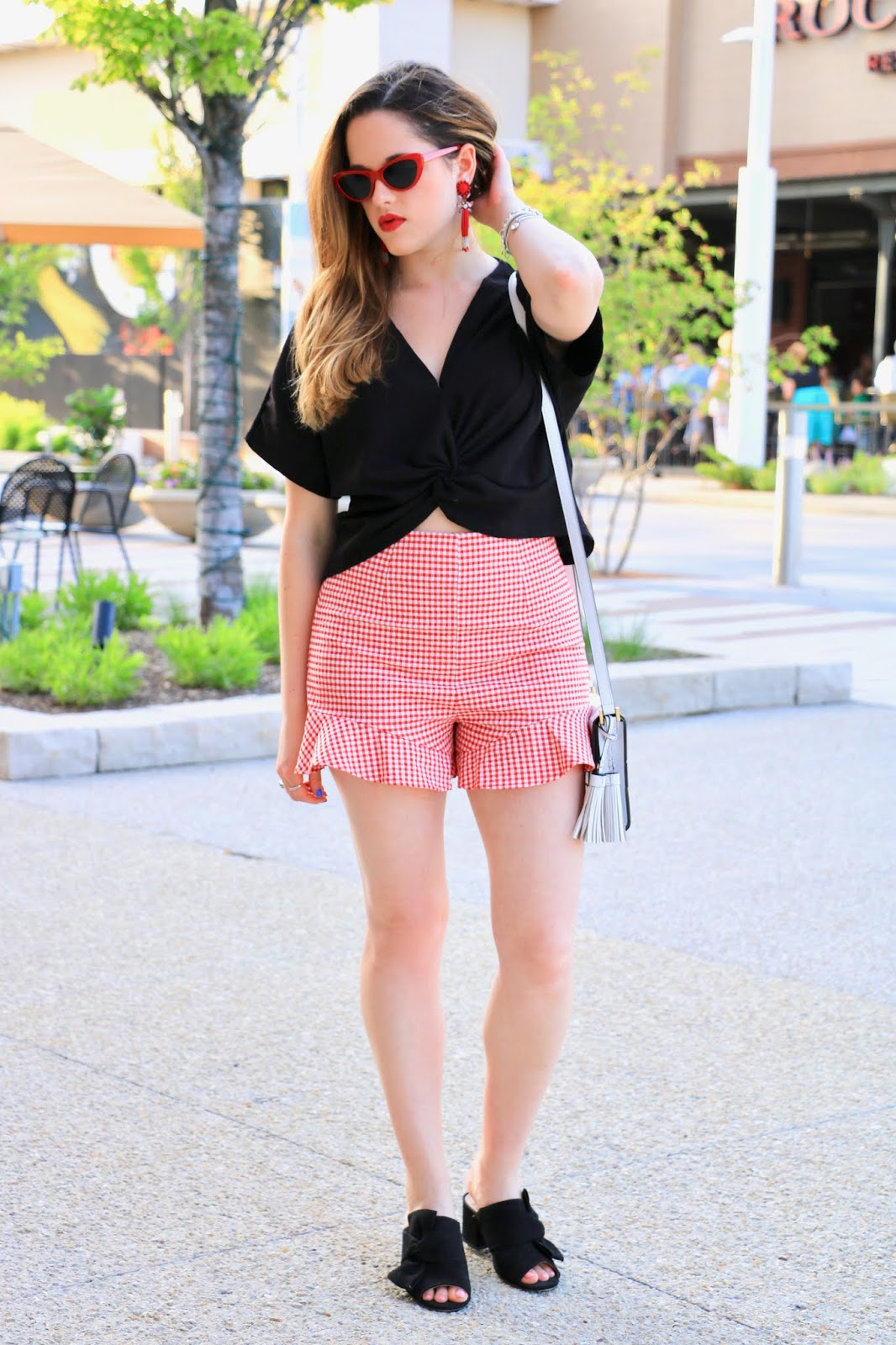 Nyc fashion blogger Kathleen Harper showing how to wear red gingham shorts