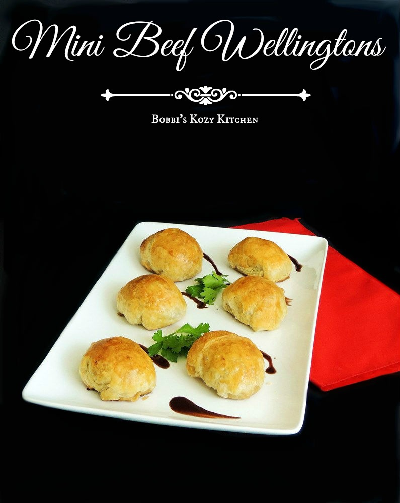 This fabulous Mini Beef Wellington appetizer recipe will have your friends raving! #beef #bestangusbeef #certifiedangusbeef #appetizer #christmas #newyearseve #recipe | bobbiskozykitchen.com