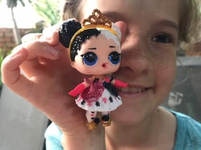 Girl with L.O.L. Surprise Bling doll Heartbreaker