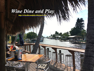 The patio of Woody's Waterside restaurant in St. James City, Florida faces a canal that leads to the Gulf of Mexico with wonderful views of Pine Island
