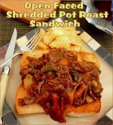 Get out your fork and knife for this Open Faced Shredded Pot Roast Sandwich. The tender roast is slow cooked in the crock pot with vegetables, shredded and served over toasted Italian bread. | Recipe developed by www.BakingInATornado.com | #recipe #crockpot