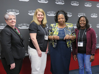 SC AHEC Executive Director Ann Lefebvre and LC AHEC HPS Coordinators Emily Warren and Kim Stephens present Ms. Fludd with the award