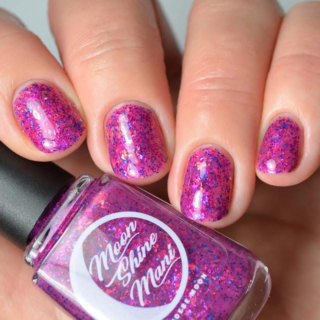 magenta glitter nail polish swatch