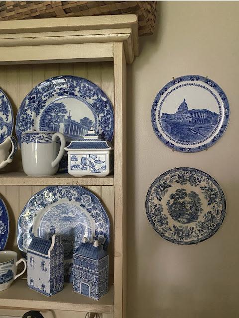 blue and white transferware plates display