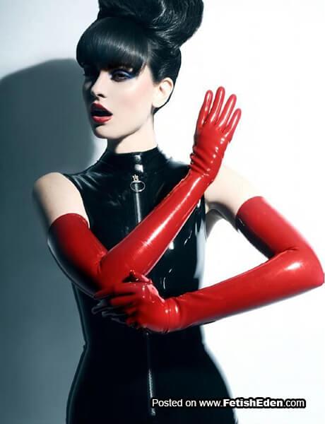 Long red latex gloved brunette in black latex sleeveless dress