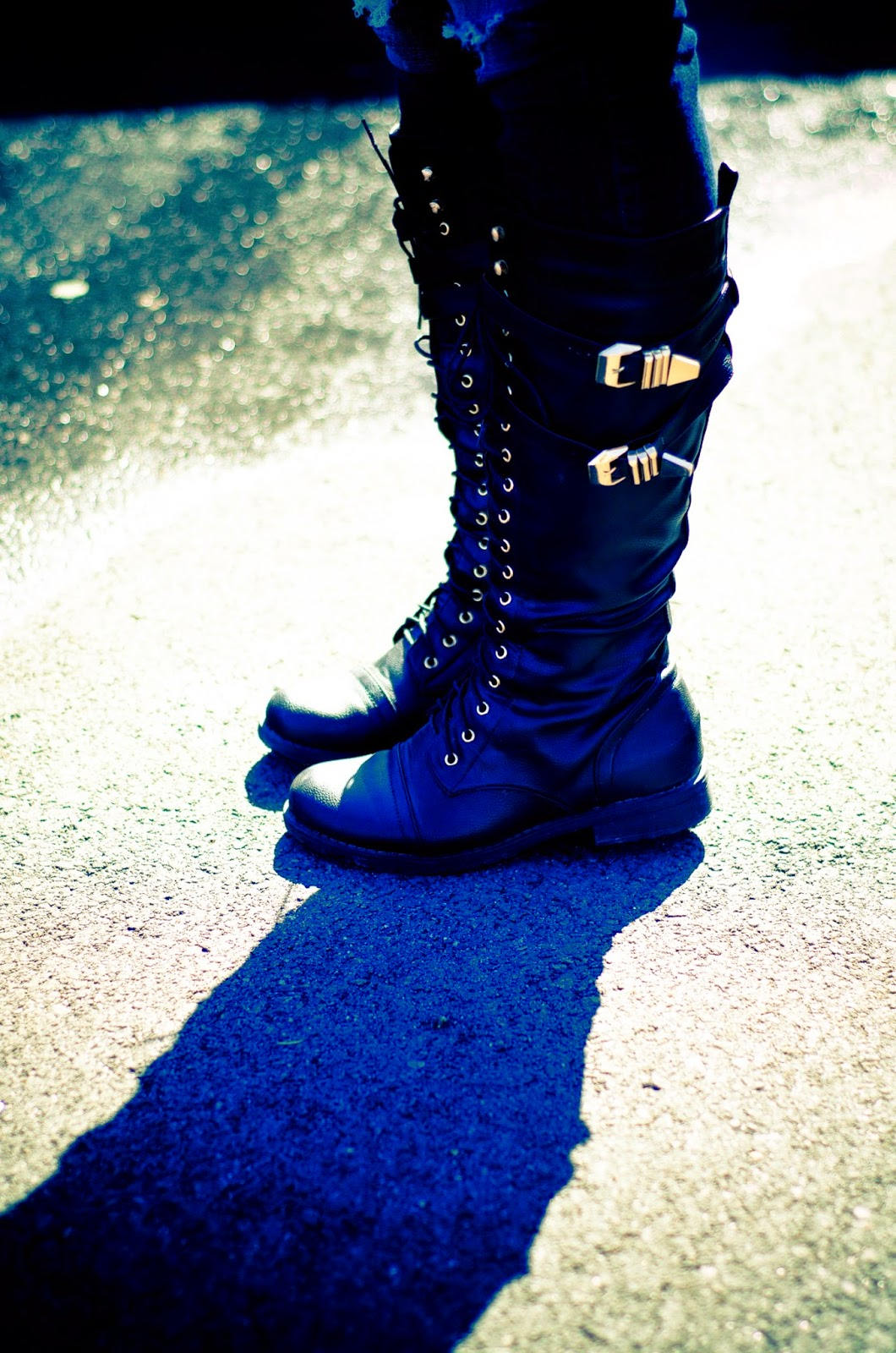 combat boots with destroyed denim