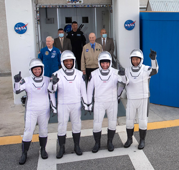 Crew-1 astronauts Shannon Walker, Victor Glover, Mike Hopkins and Soichi Noguchi greet the crowd gathered outside the Neil A. Armstrong Operations and Checkout Building prior to heading out to Launch Complex 39A to board their Falcon 9 rocket for flight...on November 15, 2020.