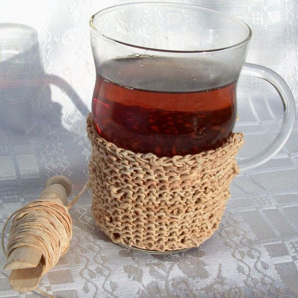 cup of tea with a crocheted cozy made of tea-dyed paper twine