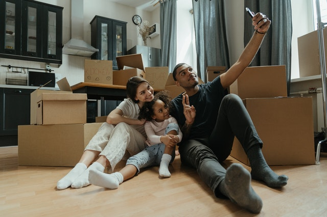 family in the kitchen, unpacking the kitchen, family move, tips for unpacking