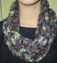 http://www.ravelry.com/patterns/library/scarf-cowl---tour-de-cou---cuello-angele-lumiere