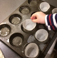 A toddler putting the cases into a tray