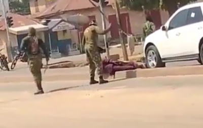 Soldiers Captured Flogging A Man With Huge Sticks In Jos (Video)