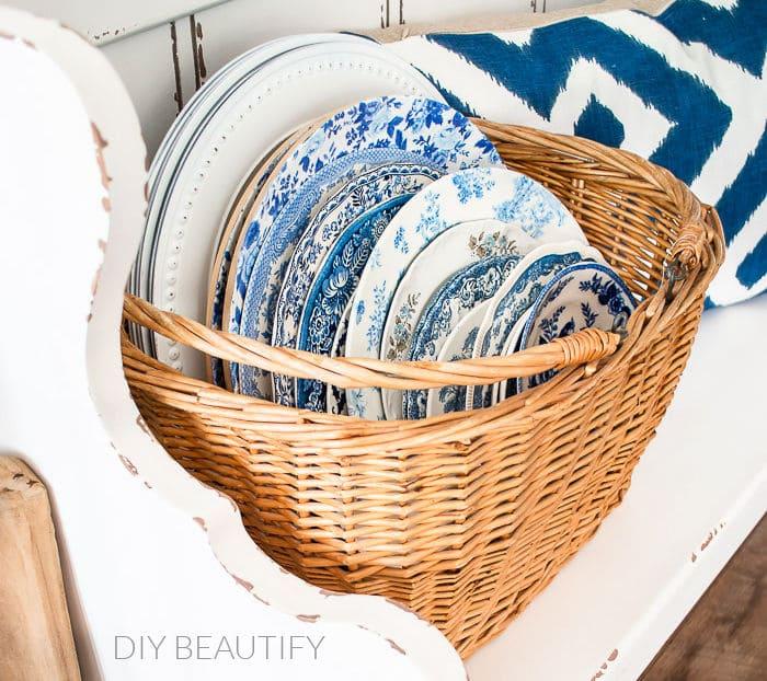 basket filled with vintage dishes