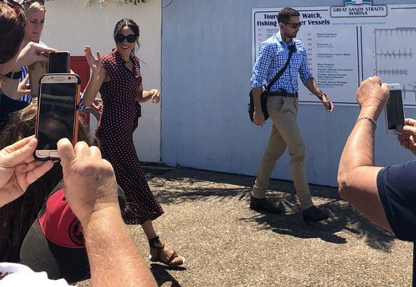 Meghan Markle wore &Other Stories Waist Knot Midi Dress and Sarah Flint Grear Lace Up Sandals. Prince Harry' Australia tour
