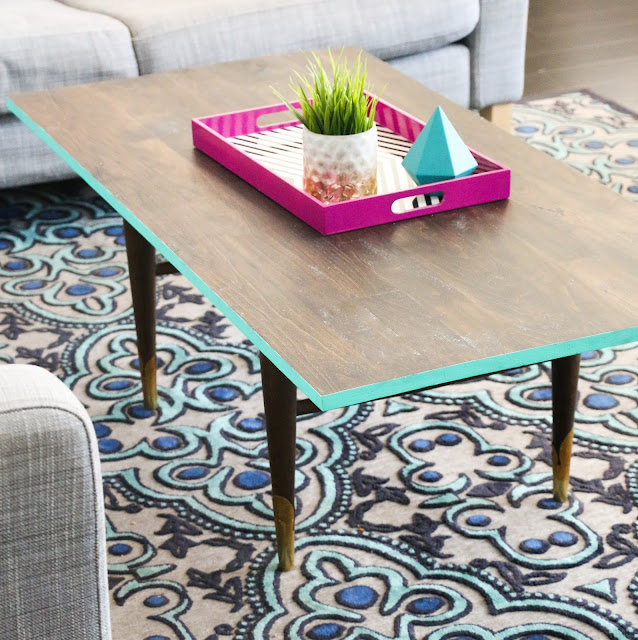 Turn a thrift store coffee table into a modern masterpiece simply by adding a new stained wood top and painting the edge.