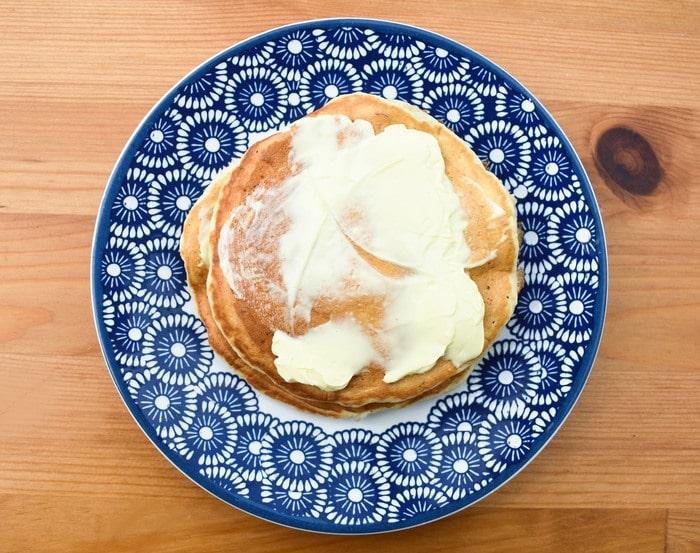 Vegan pancakes spread with vegan butter
