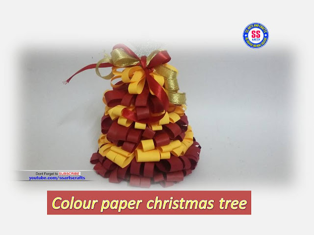 Here is paper crafts,news paper crafts,how to make christmas tree using colour papers,how to make paper wall hangings,how to make colour paper wall decors,how to make christmas ornaments,how to make christmas tree,how to make paper christmas tree nanduri lakshmi youtube channel videos