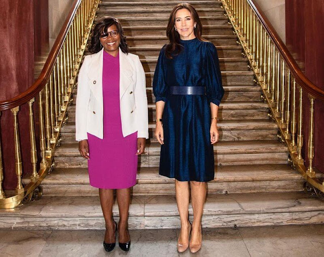 navy blue flared belted silk midi dress, and pumps from Christian Louboutin, and love gold diamond bracelet by Cartier