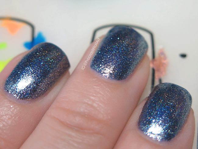 Blue metallic nail polish with linear holo glitter