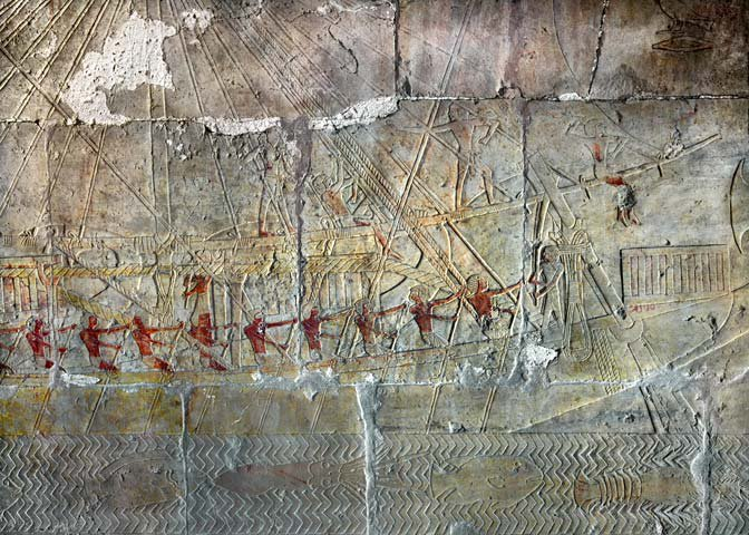 One of Hatshepsut's Punt ships setting sail, with red-painted Egyptians at the oars and Red Sea creatures swimming in the waters beneath