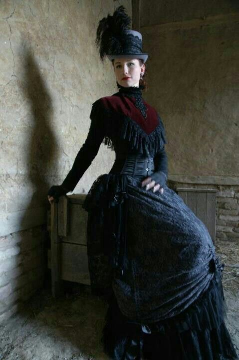 Women's gothic victorian clothing. This costume/outfit consists of corset, bodice, skirt, feathered hat in black lace.