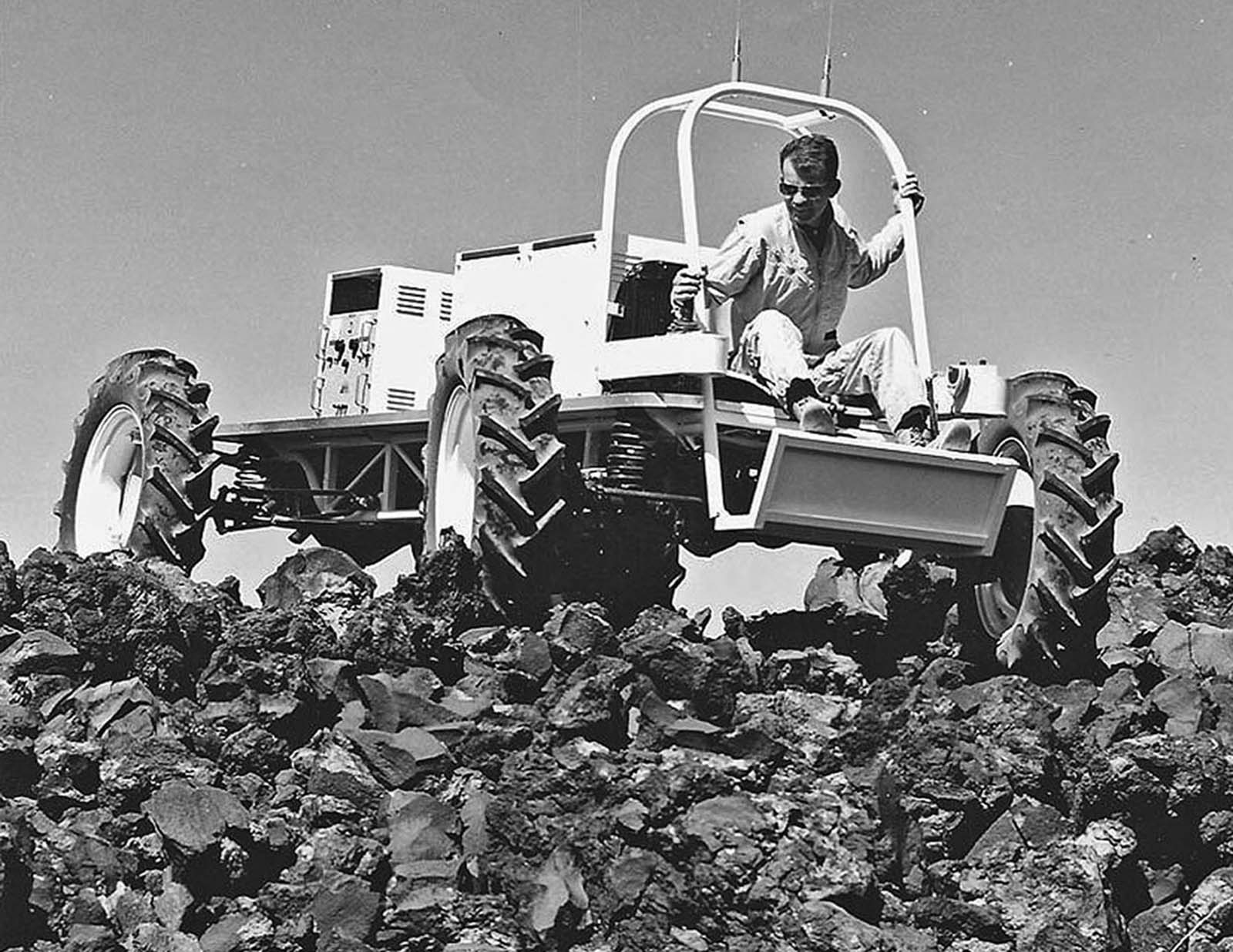 The hand-constructed Explorer vehicle, made by the astrogeology branch of USGS, is field tested in June 1967 on an extremely blocky lava flow just west of Hank's Trading Post, near Flagstaff, Arizona.