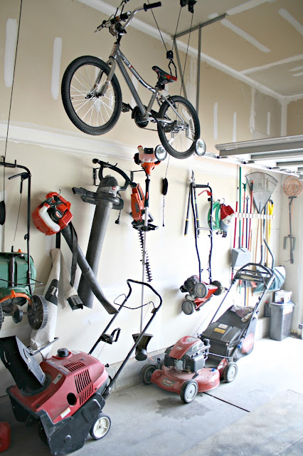 Storing lawn tools and equipment in garage
