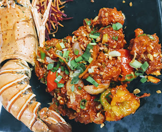 Serving lobster meat with sauce and vegetables for lobster in hot garlic sauce recipe