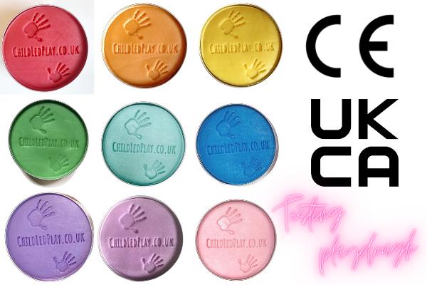 Rainbow coloured tins of playdough from childledplay.co.uk with words UKCA CE Testing playdough