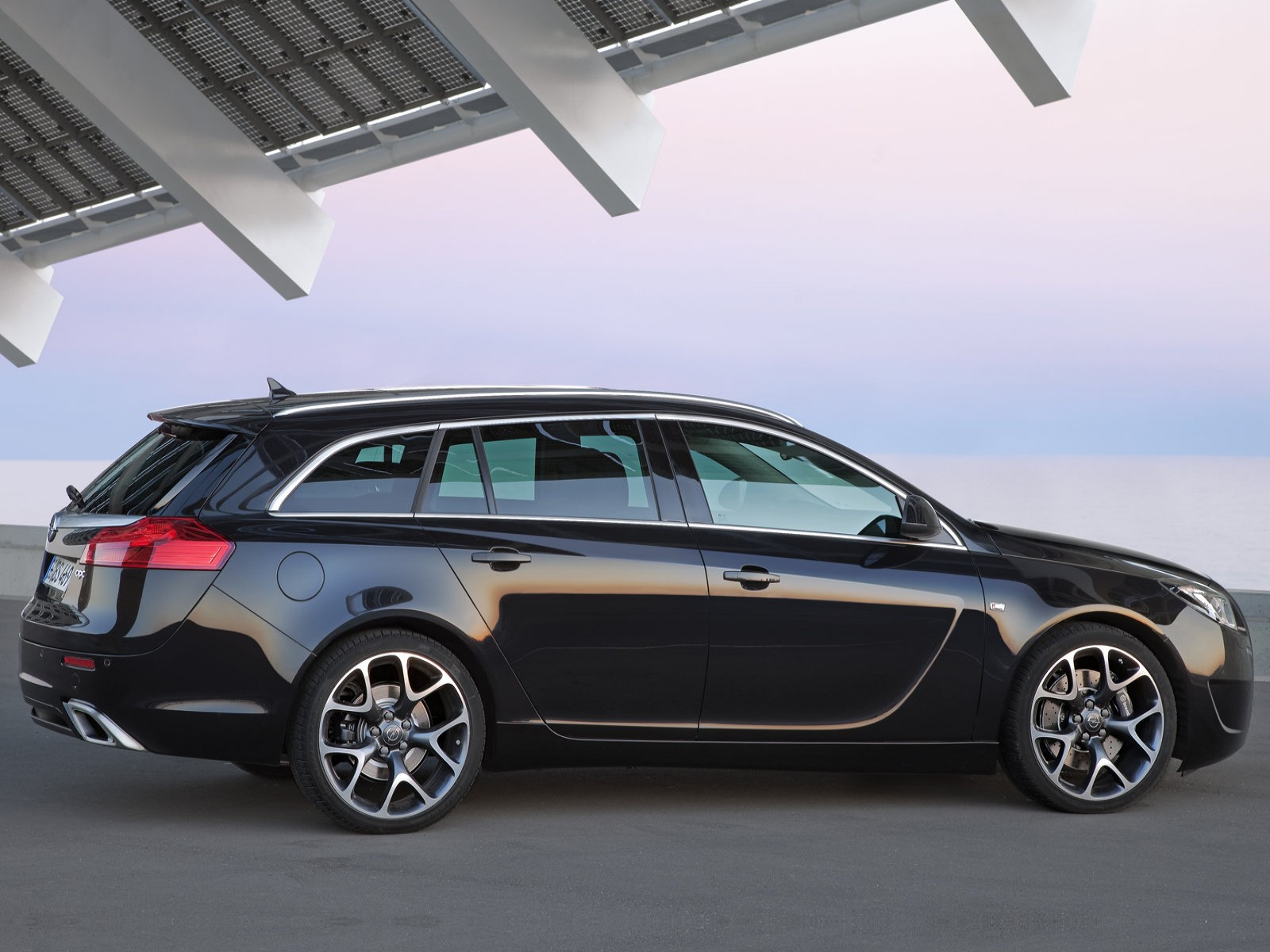 car and car zone opel insignia opc sports tourer 2010 new. Black Bedroom Furniture Sets. Home Design Ideas