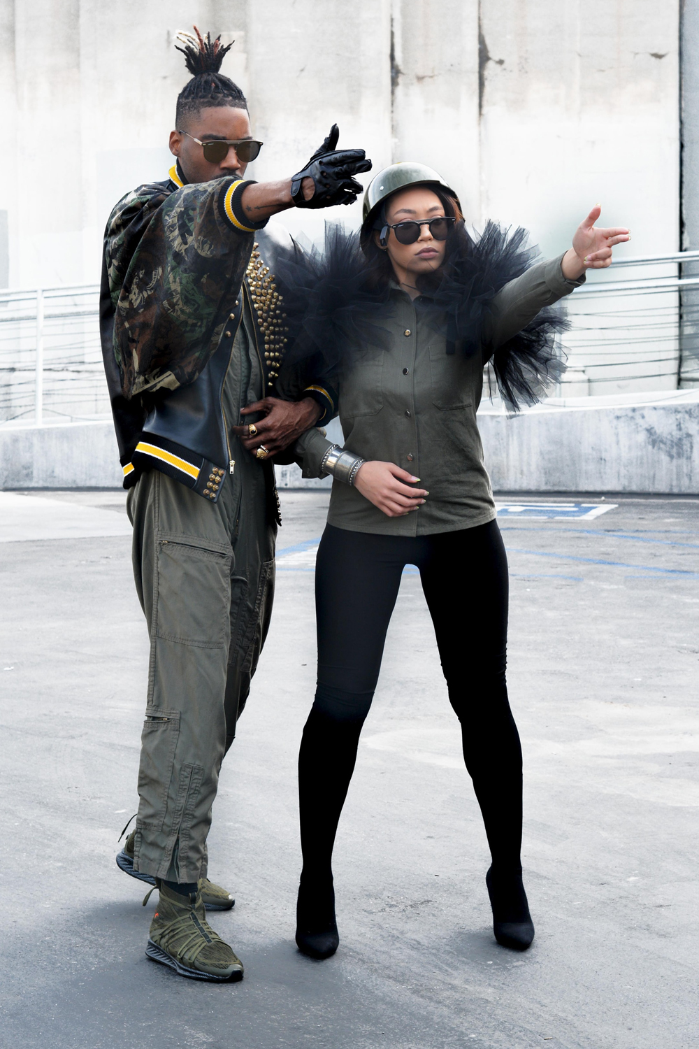 men and woman wearing military outfits and posing to the camera