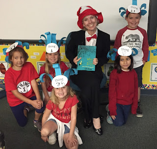 Dr. Adamson with several students for Dr. Seuss Day